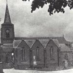 Foto 05-2 R.K. Kerk zuidzijde 1900 (JB; Opgeknapt in 1903. Afgebroken in 1960. Langs de Rijksweg tegenover het winkelcentrum)